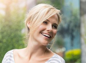 Model image of a middle aged woman with fresh skin and youthful face, used for facial rejuvenation in San Diego, CA.