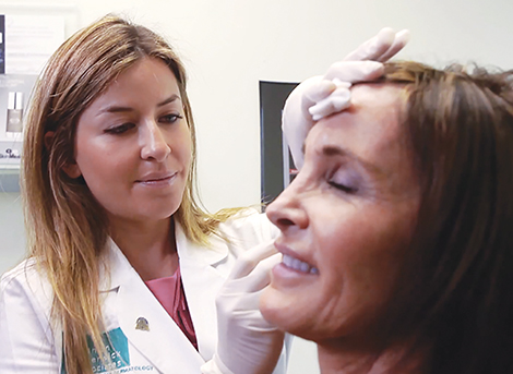 dermatologist injecting Juvederm dermal filler into a patient in San Diego, CA