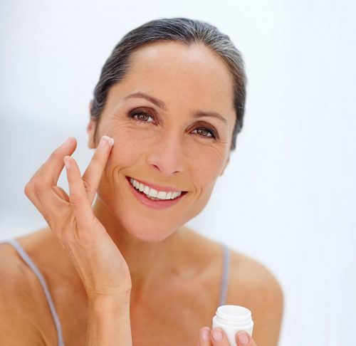 Image of woman placing skin care product on her facial wrinkles - for use in CLDerm's custom skin serum page.