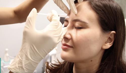 Dr. Monica Boen receiving botox injections by Dr. Douglas Wu