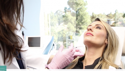 Dr. Monica Boen treating a patient's platysmal band on the neck in San Diego, CA