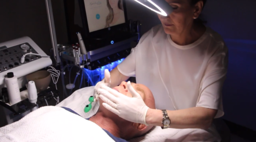 medical aesthetician treating a patient in San Diego, CA